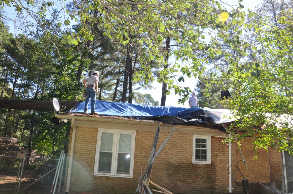 emergency tarping of storm damaged roof