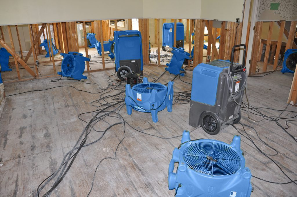 drying equipment in home flooded by Hurricane Matthew