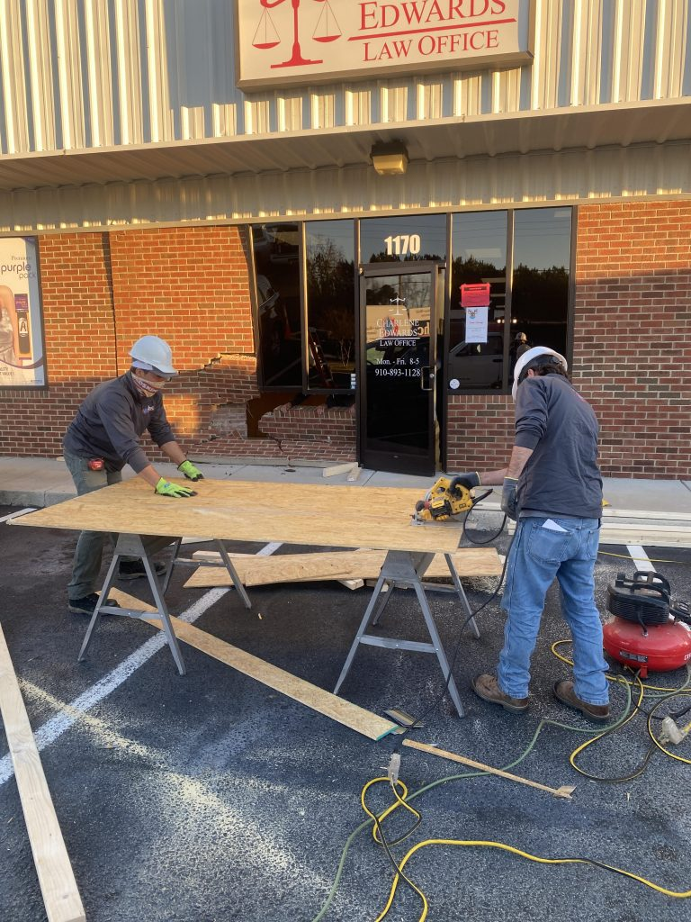 restoration workers fixing building